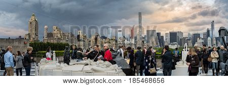 New York NY. USA - May 6 2017. people enjoy the evening at the rooftop of the Metropolitan museum of art.