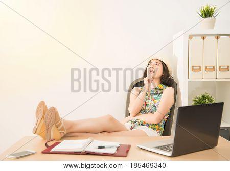 Businesswoman Lying Down On Chair Daydream