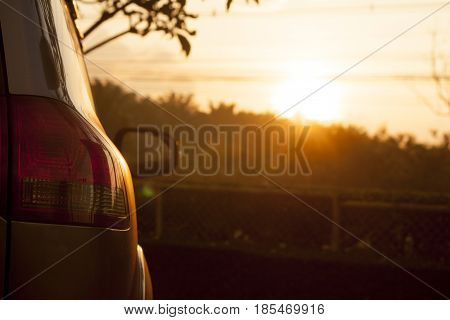Back car at parking area on morning time with sunlight.