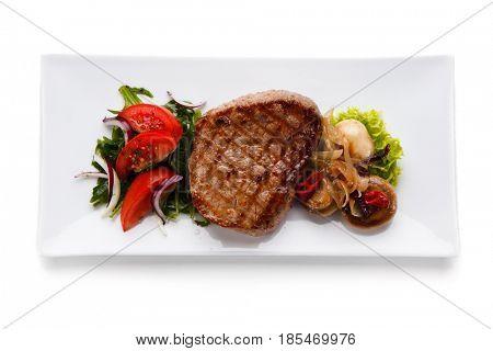 Grilled beefsteak on white background