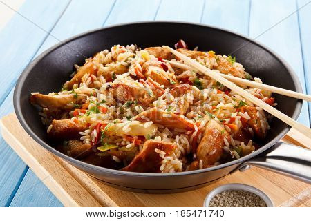 Chicken meat with rice wok