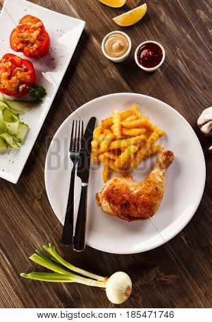 Roast chicken leg with french fries - restaurant