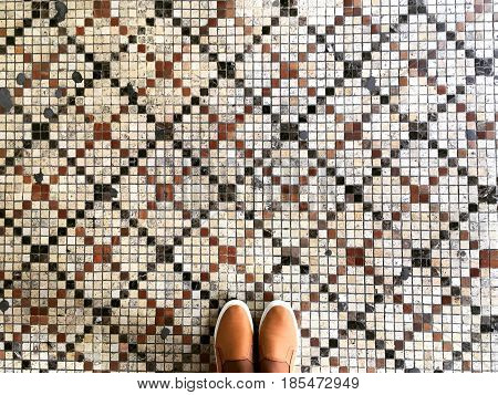 Feet and mosaic. mosaic background, mosaic border,