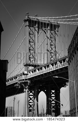 Brooklyn bridge in New York is one of the oldest bridges of either type in the United States. Completed in 1883.  Picture in black and white