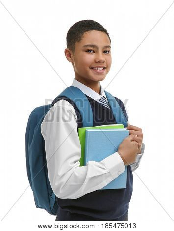 Cute boy with backpack on white background
