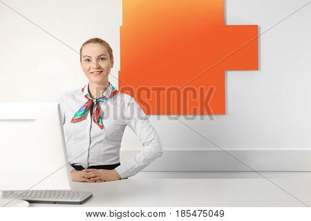 Female laundry worker standing on reception