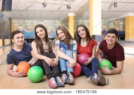 Friends having fun in bowling club