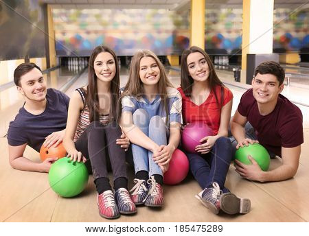 Friends having fun in bowling club