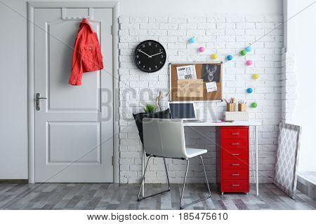 Comfortable work space in baby room