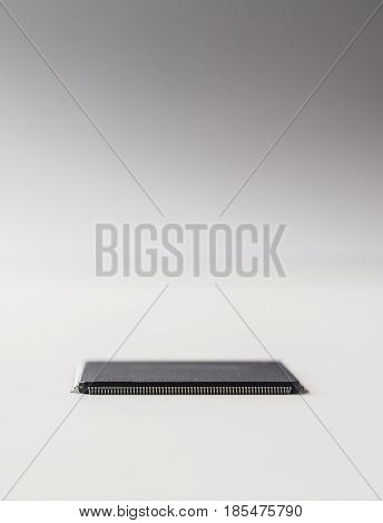 Business concept - semiconductor IC chip isolated on grey background.