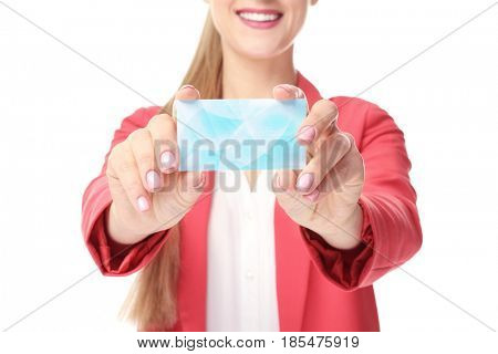 Beautiful young woman with business card on white background, closeup