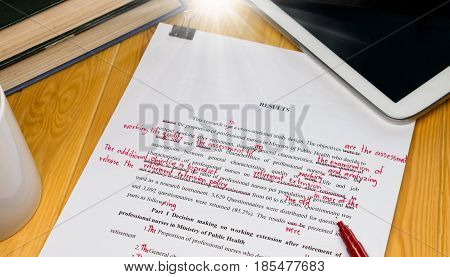 proofreading text on wooden table in office