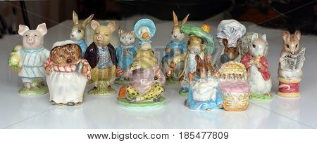 Christchurch, New Zealand - May 03, 2017: Collection of Collectable Beswick Beatrix Potter Figurines from the 1948 to 1954 period with Gold Circle stamps. Includes Little Pig Robinson Jemima Puddle-duck Hunga Munga Tailor of Gloucester Lady Mouse Benjamin