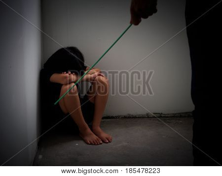 Domestic violence: female hand with Hanger on the background of kid. Abused child aggression in the family.