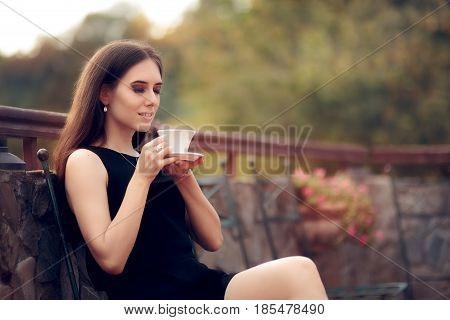 Elegant Woman Drinking a Coffee in the Garden