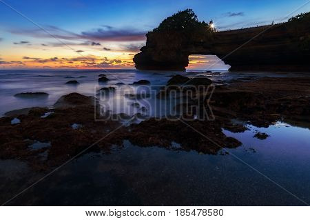 Beach Tanah Lot Temple at sunset in Bali Indonesia. Beach Sunset at Bali's famous Tanah Lot temple bali Indonesia.  twilight sky at Beach Tanah Lot temple bali Indonesia.