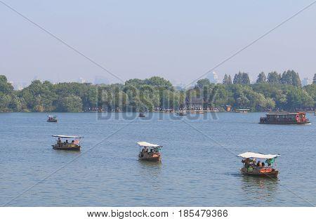 HANGZHOU CHINA - NOVEMBER 5, 2016: Unidentified people take cruise boats in West lake.