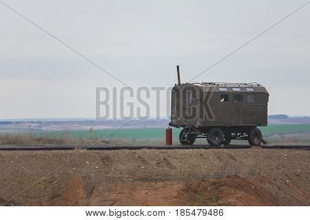 Construction Trailer on road construction work - industrial equipment among fields, telephoto