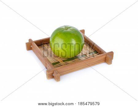 whole orange in bamboo basket with white background