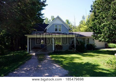 HARBOR SPRINGS, MICHIGAN, UNITED STATES - AUGUST 5, 2016: A single family home with a carport, next to the Naas Raunecker Nature Preserve on Fourth Street in Harbor Springs.