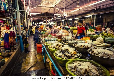 Siem Reap Cambodia - 3 April 2017: Inside of the Siem Reap Night Market where everything from fresh seafood to t-shirts are sold