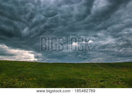 Time lapse storm clouds moving over the field. Spring landscape footage.