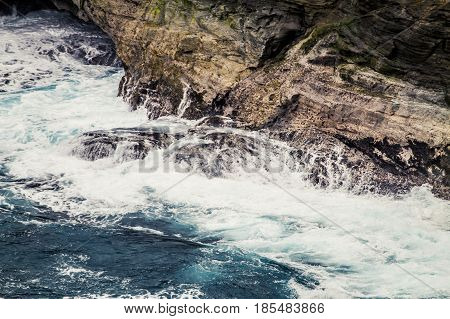 Violent Sea With Waves And Cliff