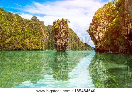Phuket Thailand island reflected in the water. James Bond island in Phang Nga bay. Famous tropical beach
