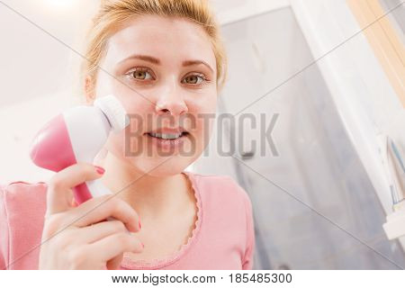 Happy Woman Using Facial Cleansing Brush