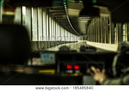 View Towards Road From Inside An Uber Car