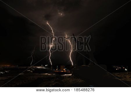 Silhouette two guy under thunder storm at night, fight with obstacle concepts