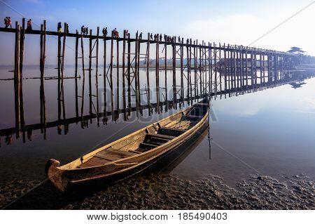 U bein bridge with vintage boat U bein bridge is longest teak Mandalay Myanmar
