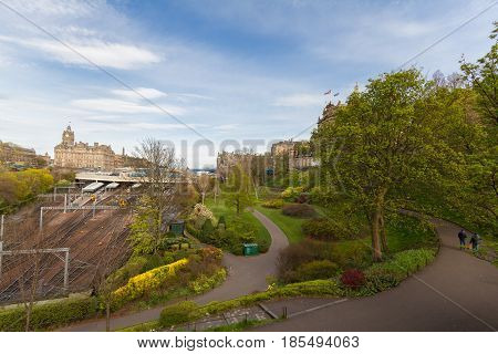 Edinburgh Scotland Skyline with Princess Street Gardens Waverly Train Station in sight on a beautiful spring afternoon