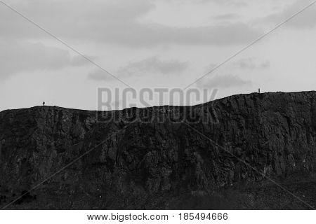 Monochrome View- Arthur's Seat Hills And Two People, Edinburgh, Scotland