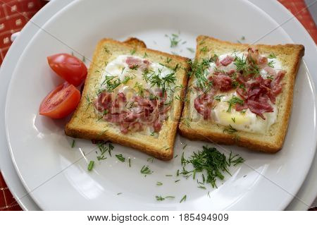 Fried eggs in bread on a plate