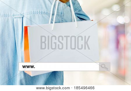 Word www. on search bar over shopping bag and blur store background online shopping background business E-commerce web banner