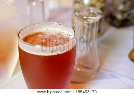 Craft beer ipa in a pint glass at a wedding reception