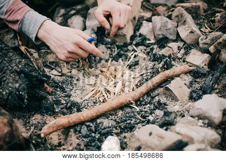 Male Hands Burning Wood Chips To Start A Campfire.