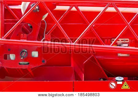 Details Of Rescue Firefighting Truck. Body Of A Fire Engine In Sunlight Closeup.