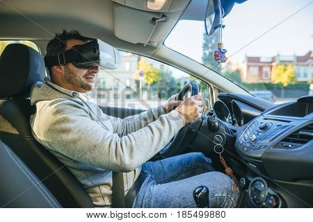 Man learning to drive with virtual reality glasses.