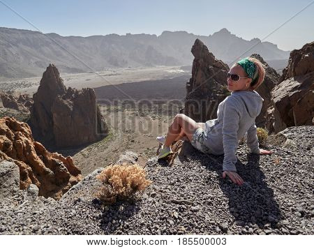 young woman admiring landscape in Teide Natural Park, Tenerife, Canary  islands, Spain