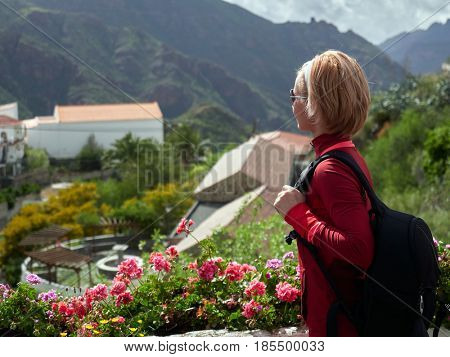 young woman tourist visiting old mountain village in Gran Canaria, Spain