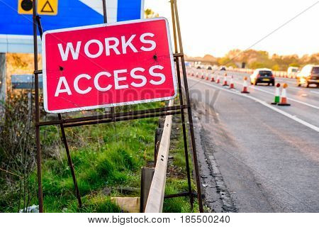 Works Access Only Sign on UK Motorway Evening.