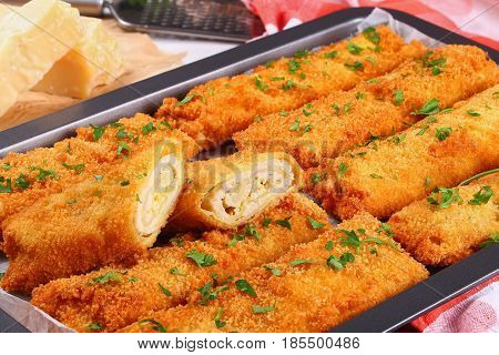Breaded Taquitos With Chicken Meat In Baking Dish