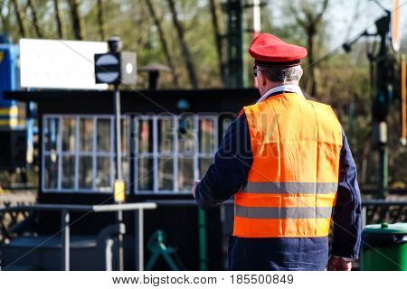 BOCHUM , GERMANY - APRIL 18 2015 : Worker observing the activities at the railway station