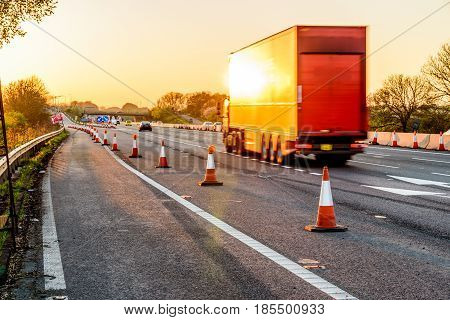 Evening view UK Motorway Services Roadworks Cones.