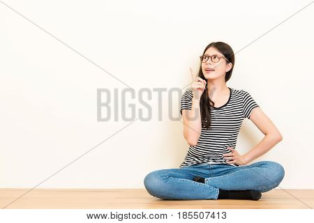 Girl Point With Finger At Blank Copyspace