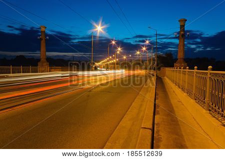 Tracers From Passing Cars On The Bridge At Dusk