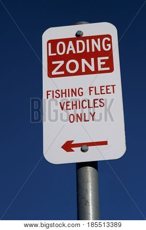Loading Zone Fishing Fleet Vehicles Only signage.