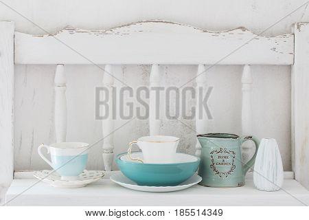 the blue dinnerware on white wooden shelf